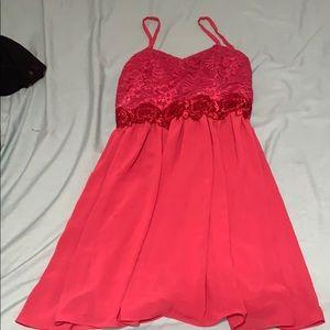 A bright pink dress.